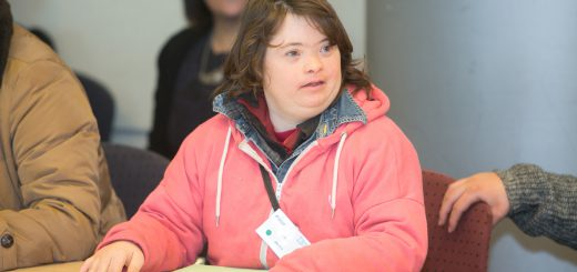 A young lady speaking at the self-advocacy meeting in Israel